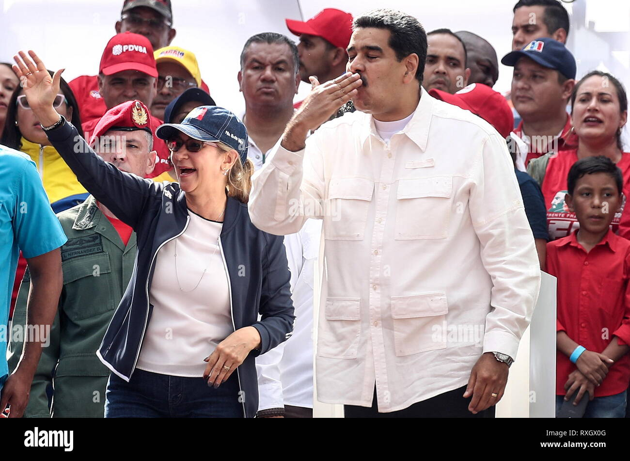 Caracas, Venezuela. 09th Mar, 2019. CARACAS, VENEZUELA - MARCH 10, 2019: Venezuela's President Nicolas Maduro (R) and his wife Cilia Flores during a rally marking Anti-imperialism Day by the Miraflores Palace. Valery Sharifulin/TASS Credit: ITAR-TASS News Agency/Alamy Live News - Stock Image