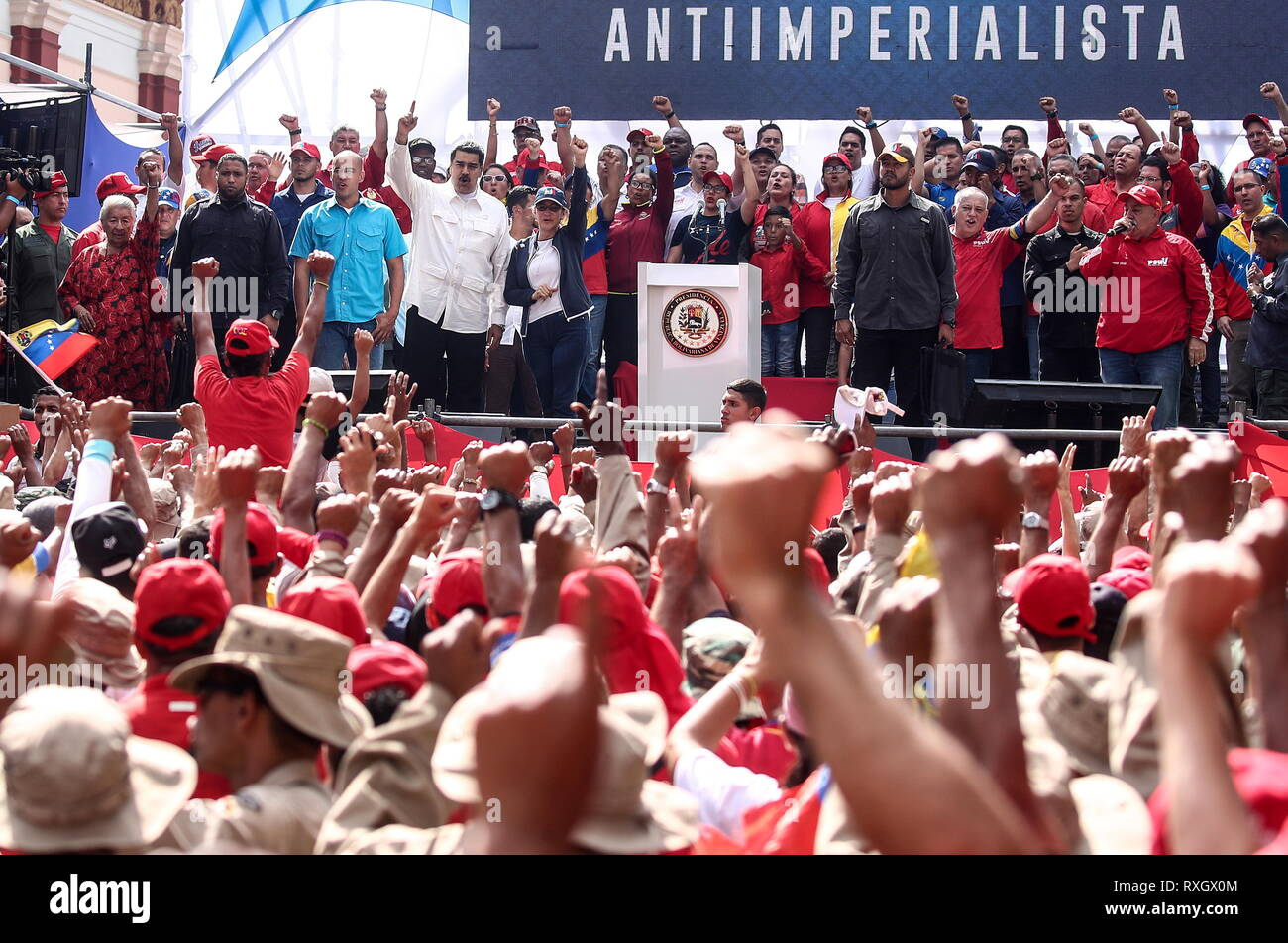 Caracas, Venezuela. 09th Mar, 2019. CARACAS, VENEZUELA - MARCH 10, 2019: Venezuela's President Nicolas Maduro and his wife Cilia Flores (C background) during a rally marking Anti-imperialism Day by the Miraflores Palace. Valery Sharifulin/TASS Credit: ITAR-TASS News Agency/Alamy Live News - Stock Image