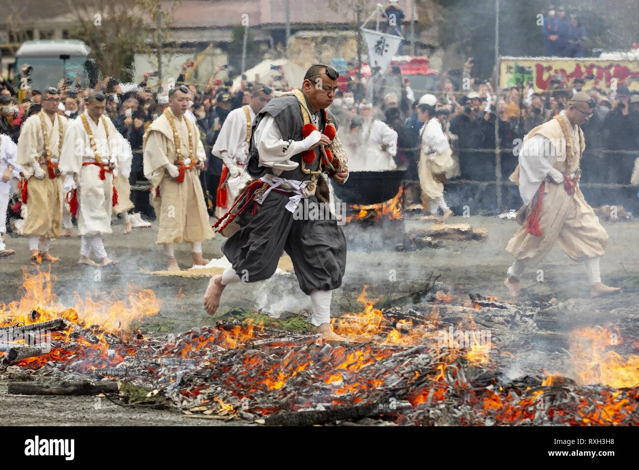 Tokyo, Japan. 10th Mar, 2019. Buddhist practitioners walk on the fire during the Hiwatari or fire-walking ceremony at Yakuo-in temple. Buddhist devotees walked over the fire with bare feet to pray for world peace and receive protection from misfortune and good health. Visitors can participate at the end of the ceremony to receive the benefits. The annual event is held on the second Sunday of March at the down skirt of Mt. Takao. Credit: Rodrigo Reyes Marin/ZUMA Wire/Alamy Live News - Stock Image