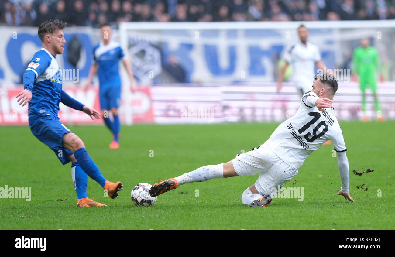 Magdeburg, Germany. 10th Mar, 2019. Soccer: 2nd Bundesliga, 25th matchday, 1st FC Magdeburg - SV Sandhausen in the MDCC-Arena in Magdeburg. Magdeburg's Philip Türp itz (l) and Sandhausen's Leart Paqarada fight for the ball. Credit: Peter Steffen/dpa - IMPORTANT NOTE: In accordance with the requirements of the DFL Deutsche Fußball Liga or the DFB Deutscher Fußball-Bund, it is prohibited to use or have used photographs taken in the stadium and/or the match in the form of sequence images and/or video-like photo sequences./dpa/Alamy Live News - Stock Image