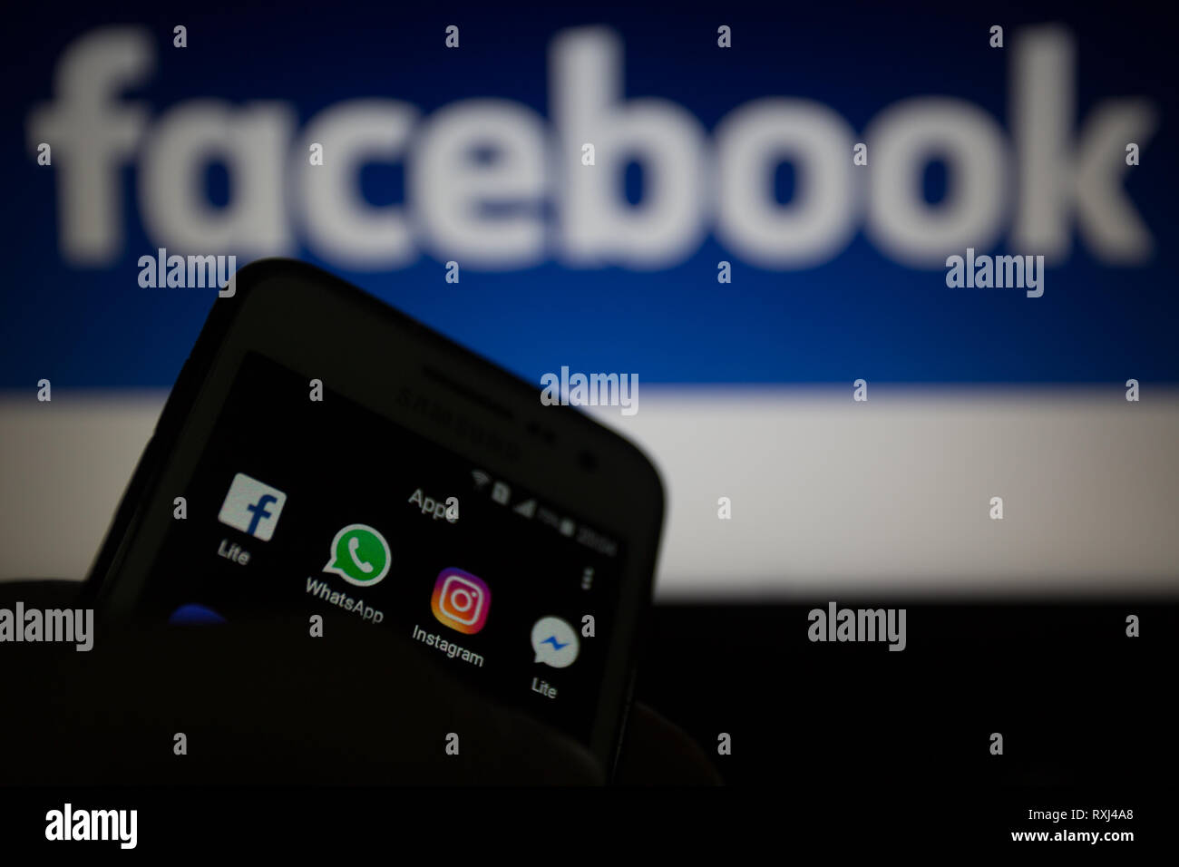 Facebook Lite, WhatsApp, Instagram and Messenger Lite icons, logos are shown on smartphone display. Facebook plans to integrate its messaging services - Stock Image