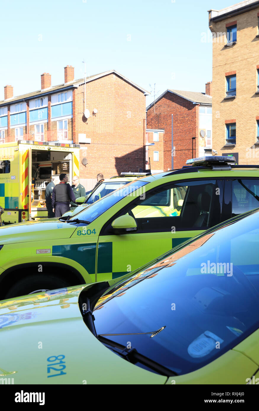 Paramedics and ambulances in Canning Town, east London England, UK - Stock Image
