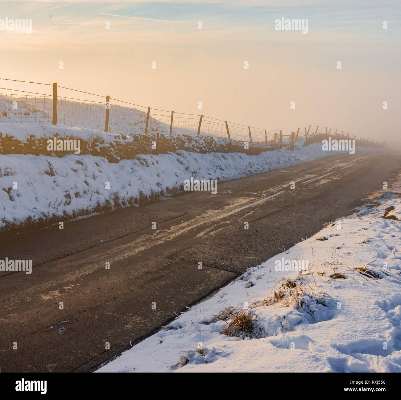 A deep fog rises from a country road in the middle of winter, 2019 Stock Photo