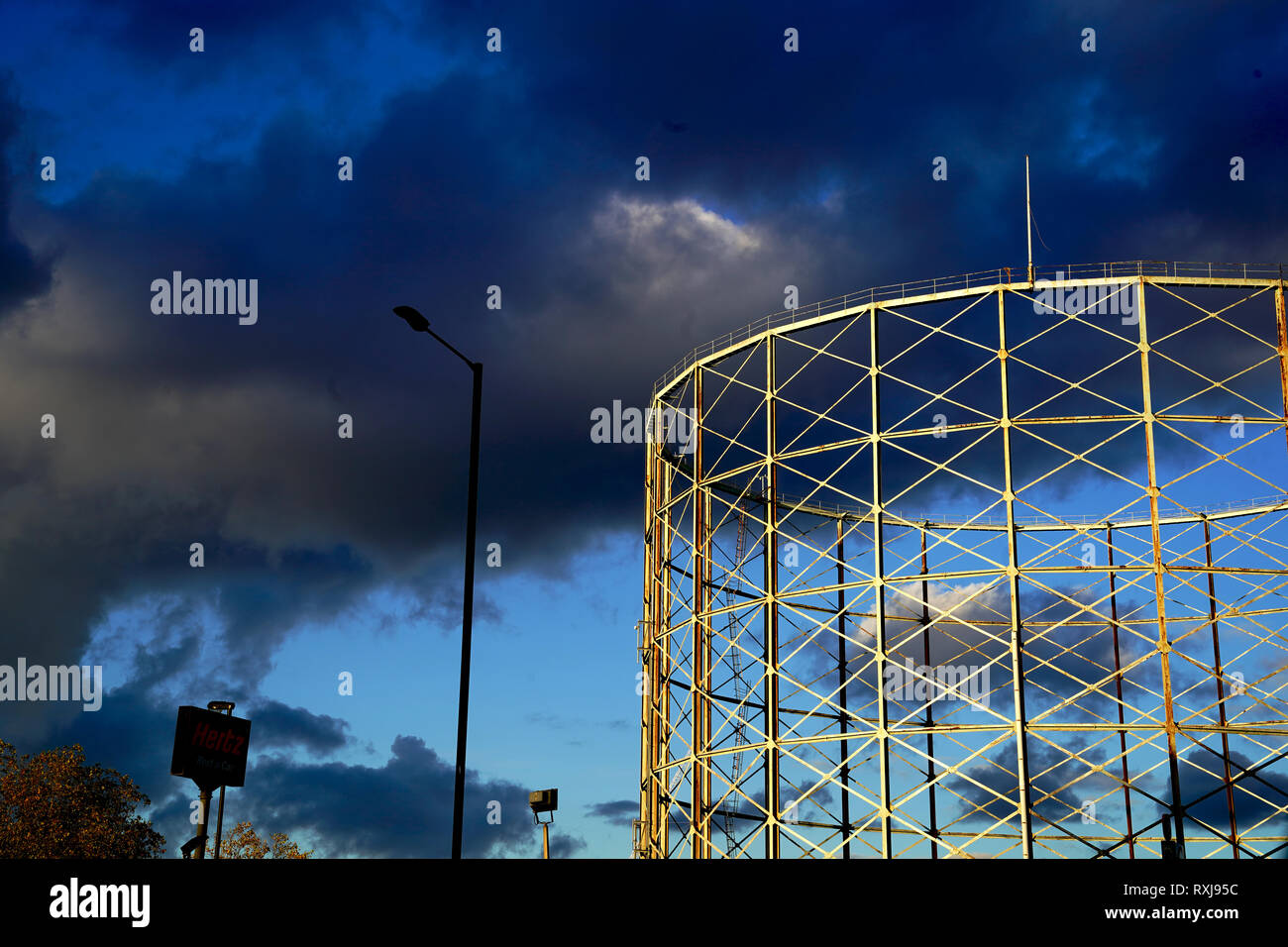 Dramatic sky over a Gasometer in south London. - Stock Image