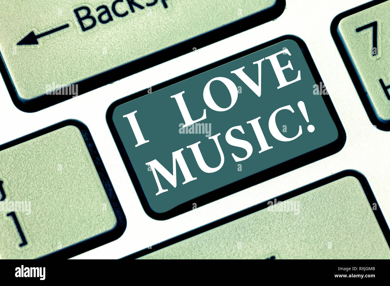 Text sign showing I Love Music. Conceptual photo Having affection for good sounds lyric singers musicians Keyboard key Intention to create computer me - Stock Image