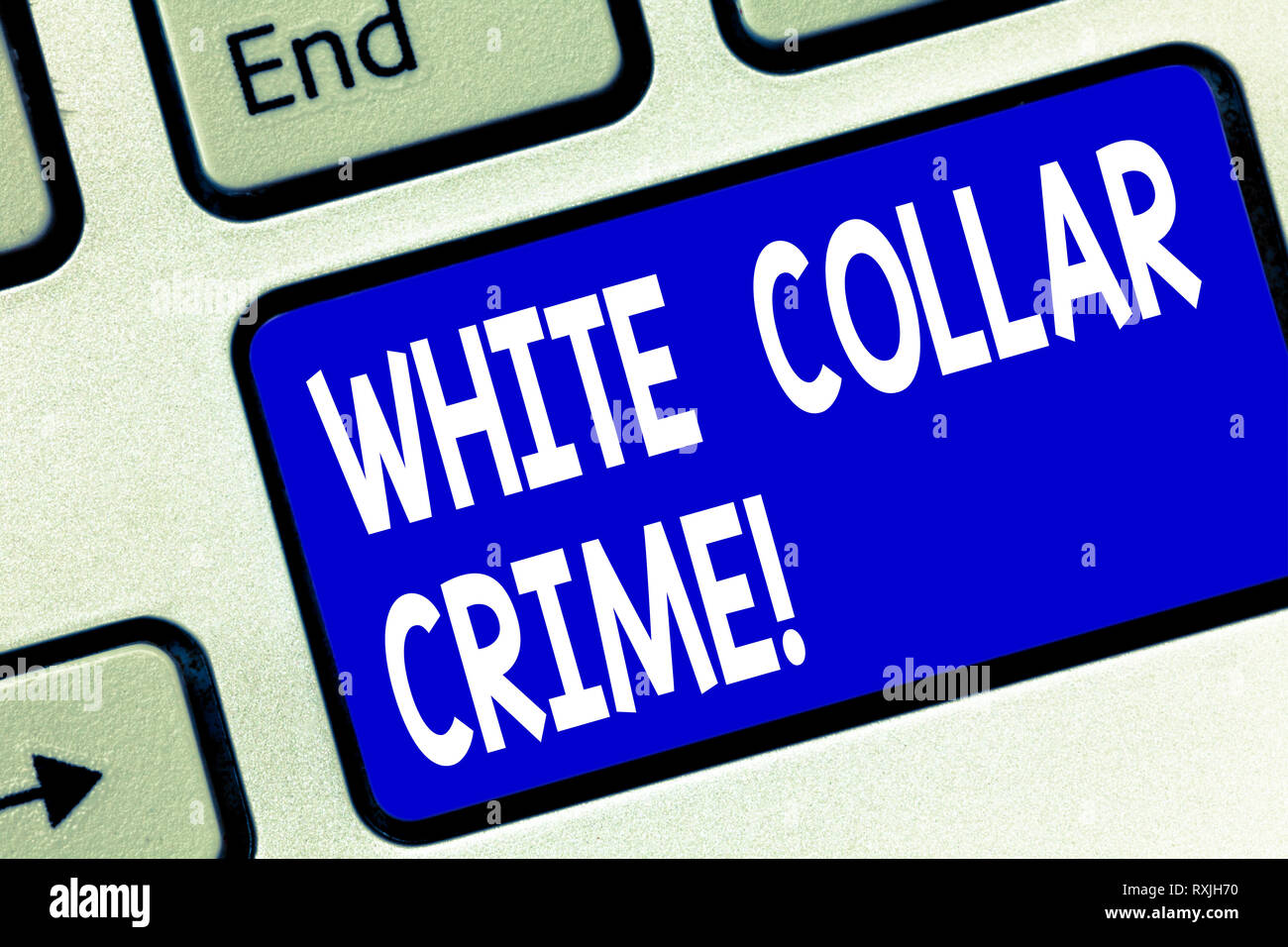 Writing note showing White Collar Crime. Business photo showcasing refers financially motivated nonviolent crime by business Keyboard key Intention to - Stock Image