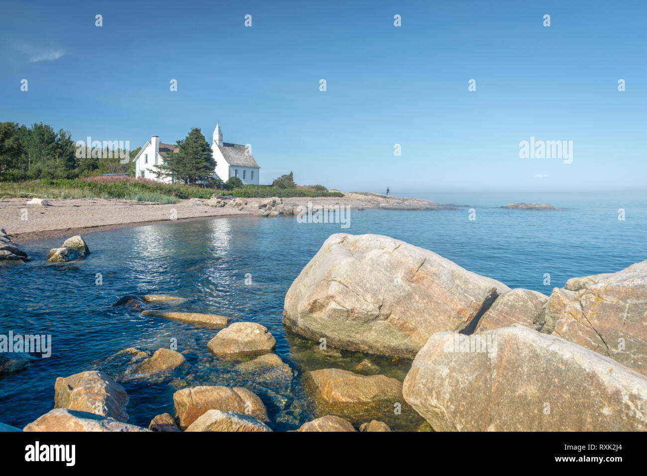 View on the McLaren chapel set on the shore of the St.Lawrence River in Port-au-Persil, province of Quebec, Canada Stock Photo