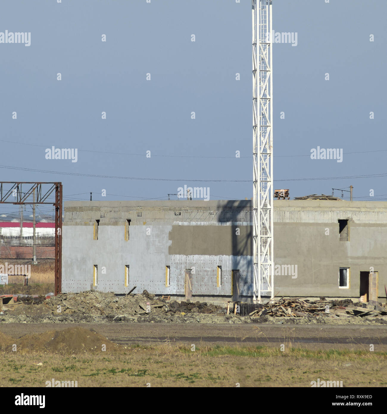 Building under construction. The construction of auxiliary buildings at the refinery. Stock Photo