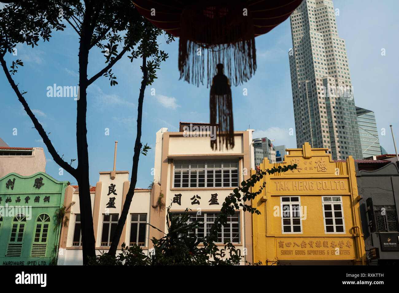 08.03.2019, Singapore, Republic of Singapore, Asia - Old buildings along South Bridge Road with modern skyscraper of the central business district. - Stock Image