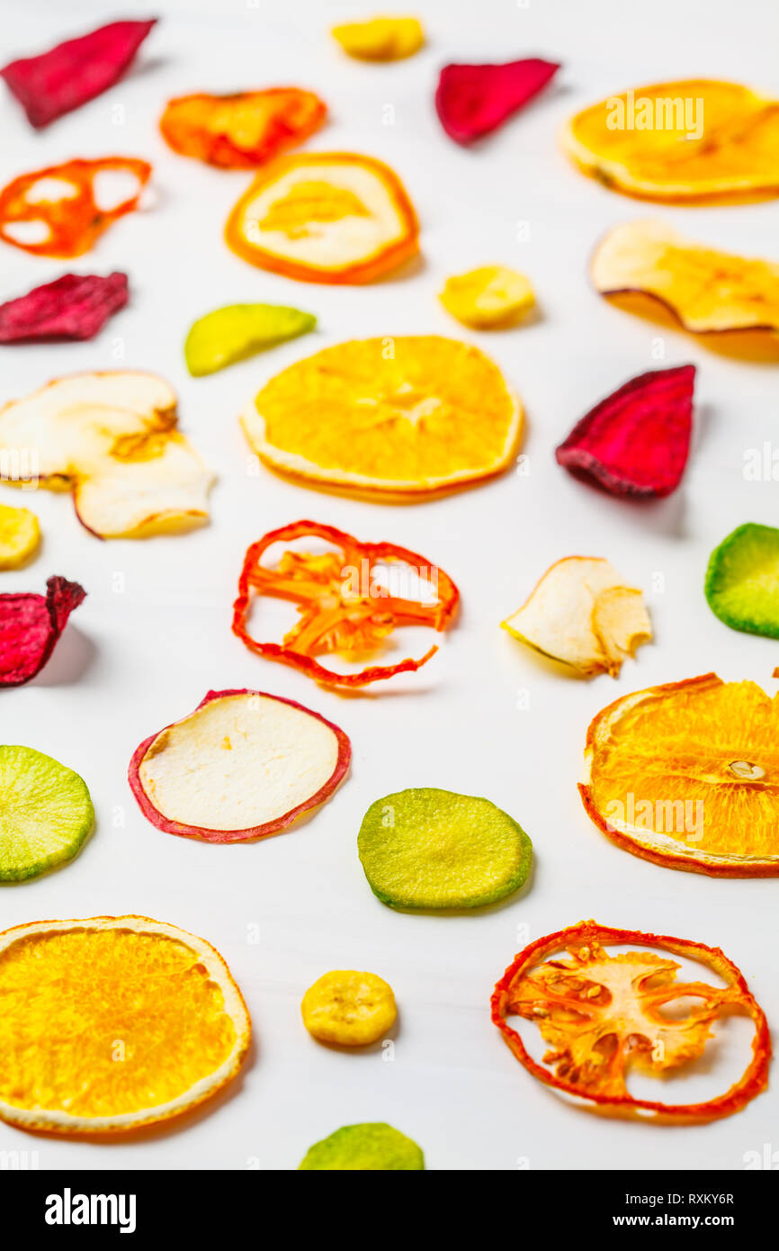 Dried vegetables and fruits on a white background. Plant based food concept. - Stock Image