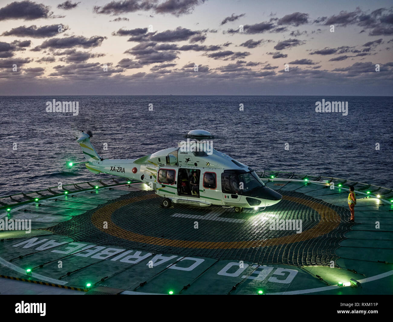 An Augusta 155 Medevac Helicopter on deck of a Ship for a Night Landing in the Gulf Of Mexico to pick up a Walking Casualty. Mexico - Stock Image