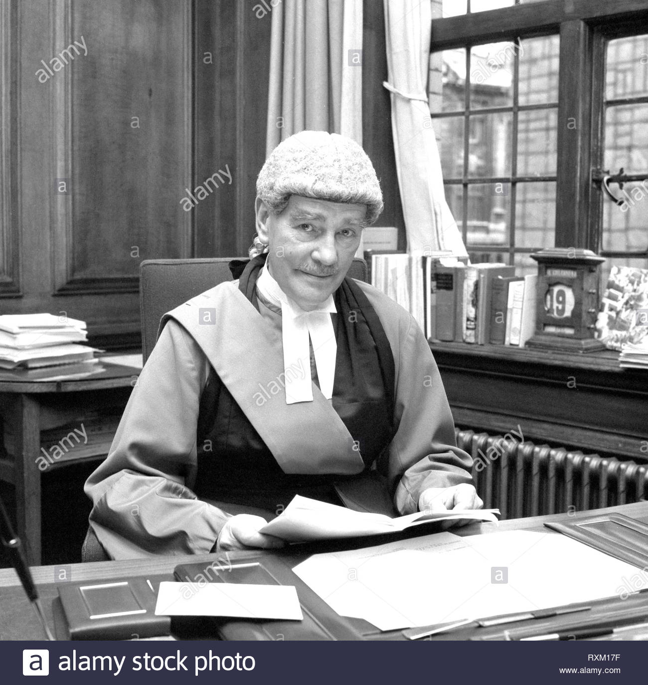 File photo dated 19/4/1972 of Lord Widgery, the Lord Chief Justice, in his room at the Old Baily as he looks through his report on the 'Bloody Sunday' shootings in Londonderry. - Stock Image