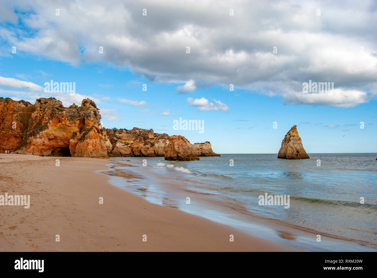 Sandy cloudy beach Dos Tres Irmaos spring view in Algarve, Portugal Stock Photo