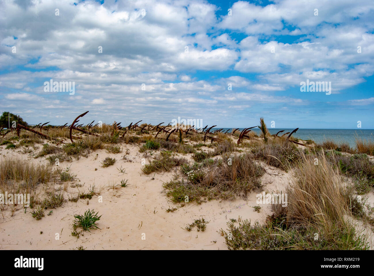 Cemetery of anchors on the beach at Praia Do Barril in Santa Luzia, Algarve, Portugal, Stock Photo