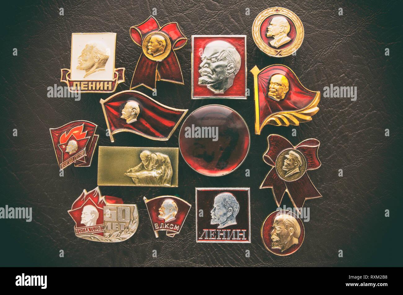 Many metal soviet badges with the image of Communist leader Vladimir Lenin - Stock Image