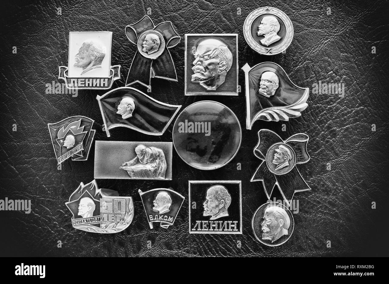 Metal soviet badges with the image of Communist leader Vladimir Lenin in black-white stylization - Stock Image