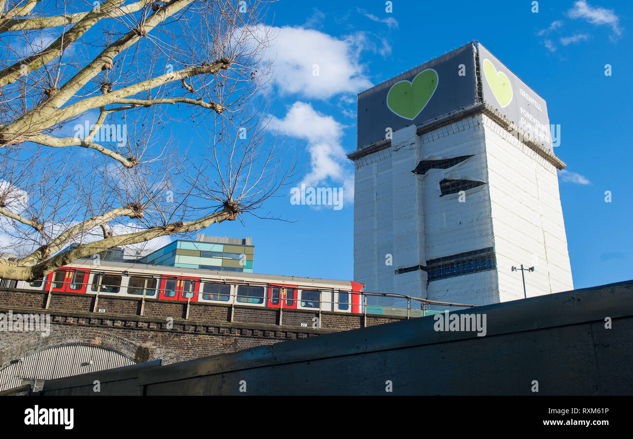 Grenfell Tower, in west London, after high winds damaged plastic sheeting covering the building. - Stock Image