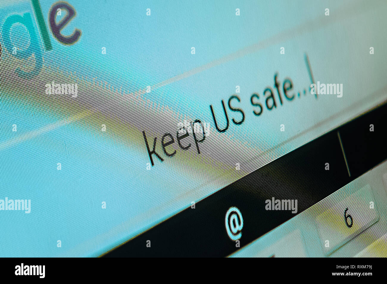 On the computer screen is written: 'keep US safe'. - Stock Image
