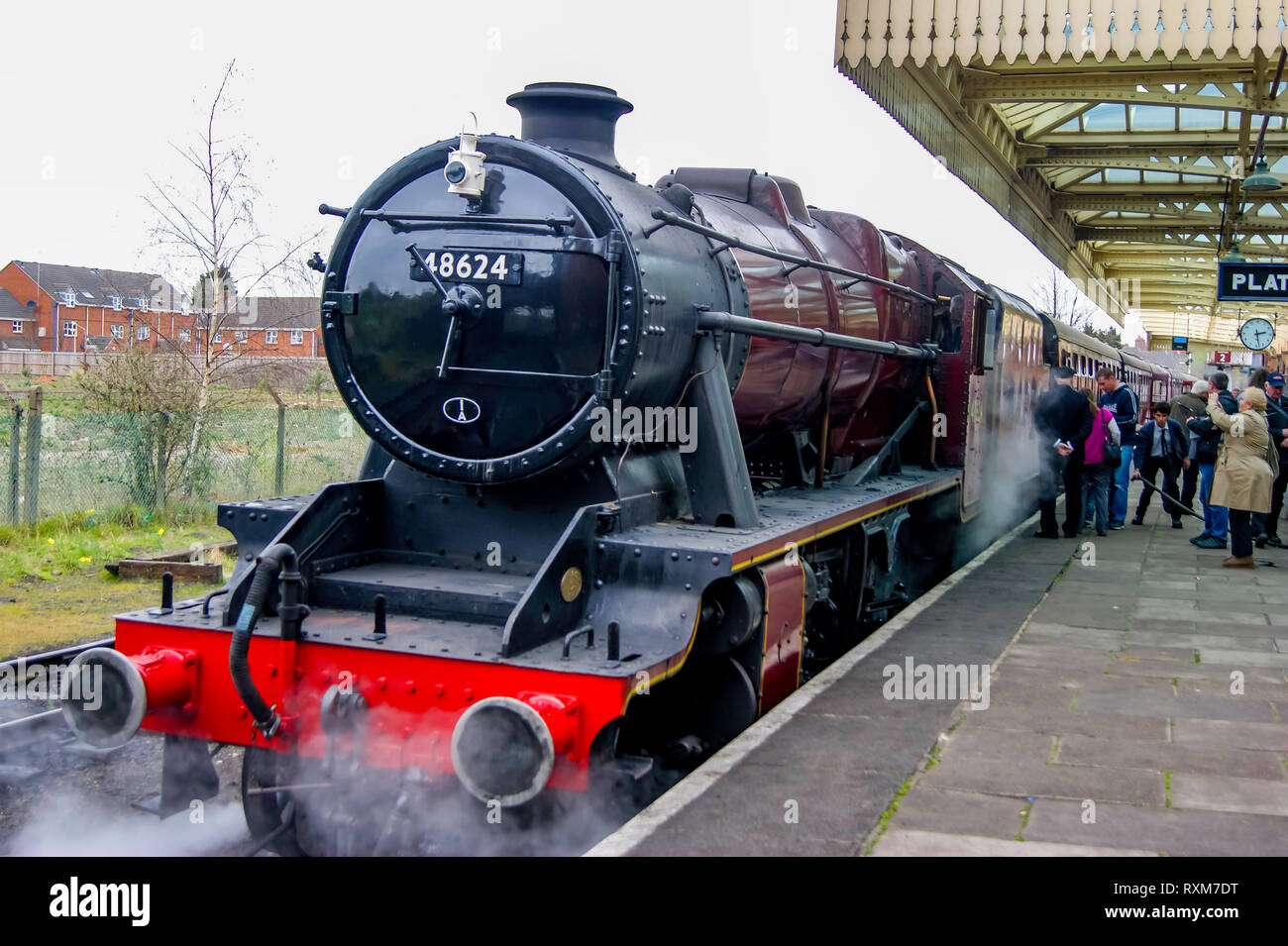 LMS Stanier class 8F 2-8-0 awaiting departure at loughborough station on route to Leicester on The Great Central Railway - Stock Image