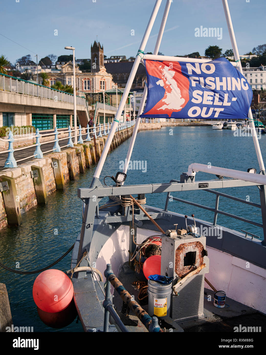 No Fishing Sell Out. A banner flown from the bow of a fishing trawler. - Stock Image