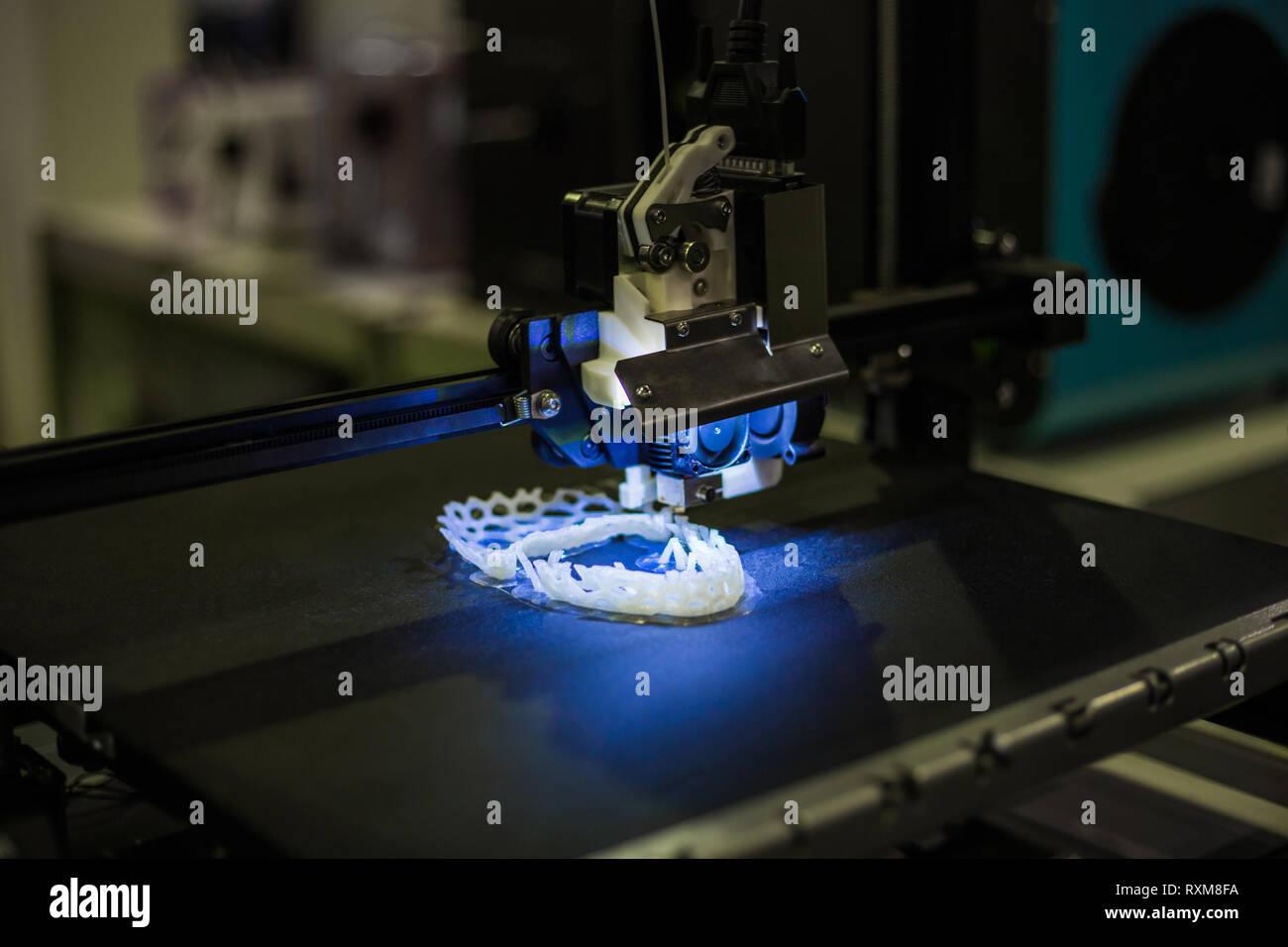 Automatic three dimensional 3D printer machine printing plastic model - Stock Image