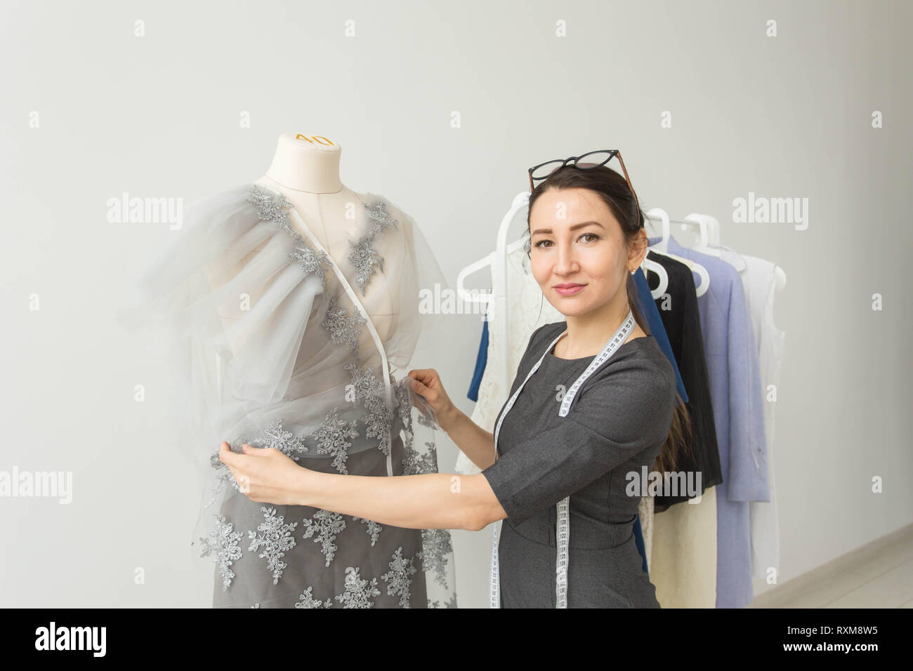 Dressmaker Fashion Designer Tailor And People Concept Beautiful Fashion Woman Designer Standing In Studio Stock Photo Alamy