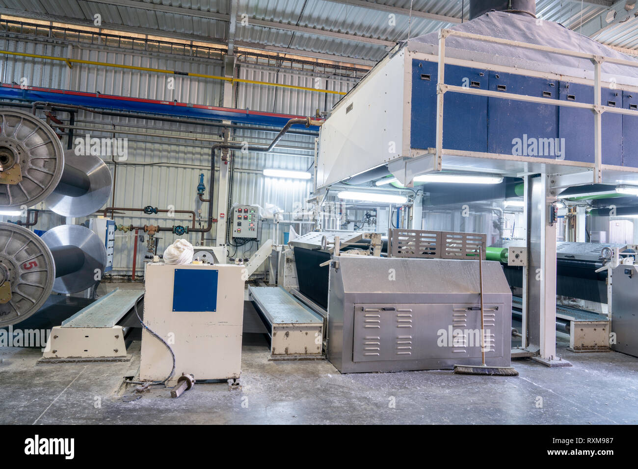 Interior of Textile factory with automated machinery.Concept of Industry and Technology - Stock Image