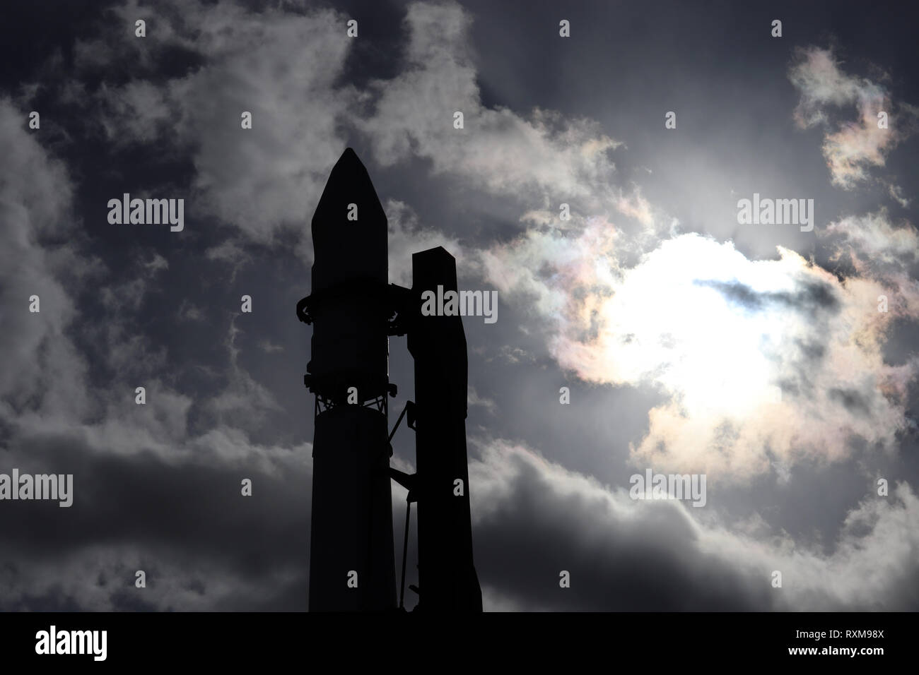 Space shuttle silhouette against the cloudy sky. Spaceship on the launch pad before starting, astronautics and cosmodrome concept - Stock Image