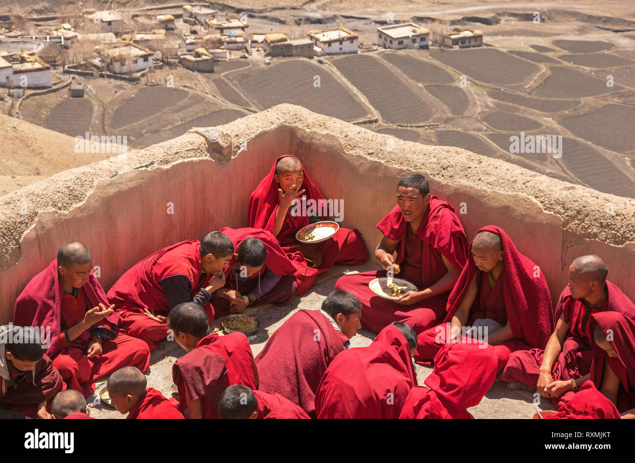 SPITI, INDIA - APRIL 28, 2016: group of young monks practicing Tibetan Buddhism have breakfast on the roof of the Key Monastery in Spiti, India on Apr - Stock Image
