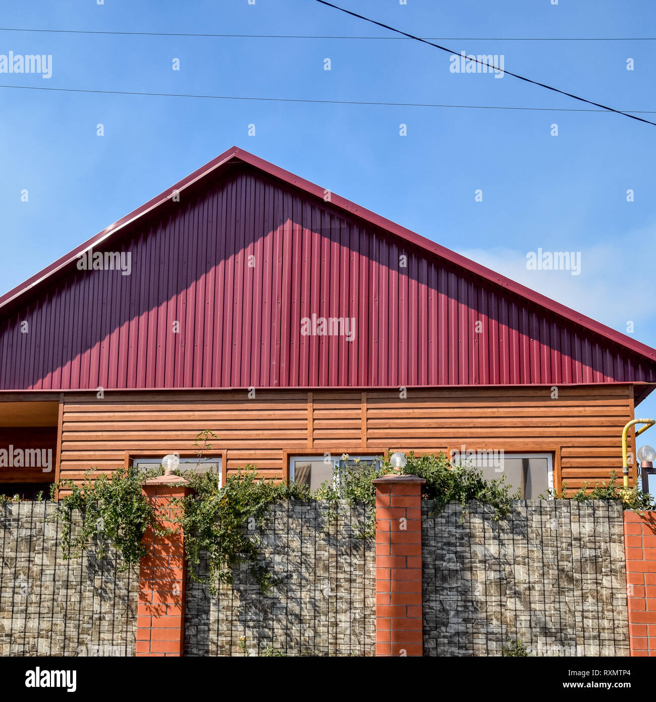Detached House With A Roof Made Of Steel Sheets Roof Metal Sheets Modern Types Of Roofing Materials Stock Photo Alamy