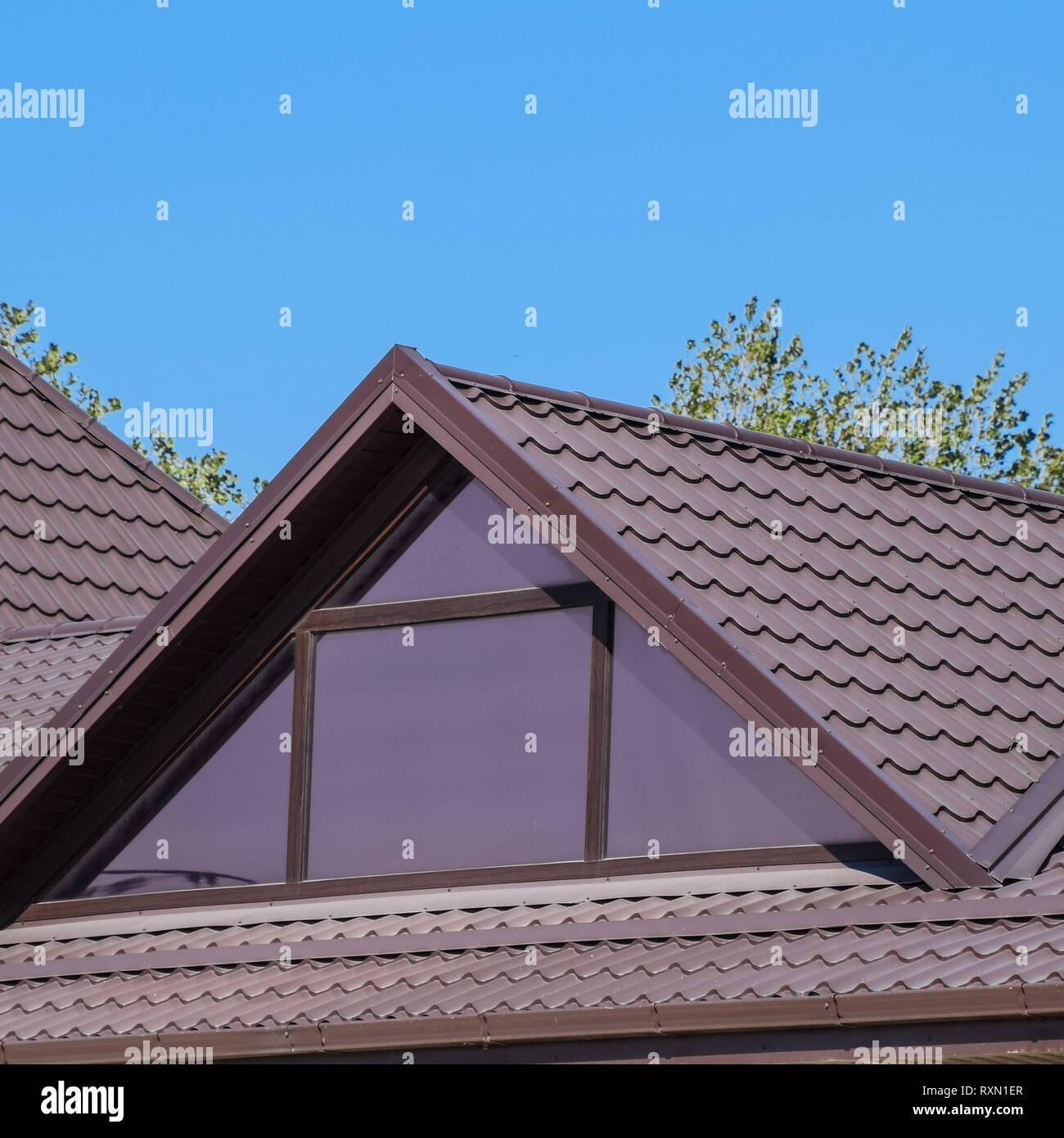 House With Plastic Windows And A Brown Roof Of Corrugated Sheet Roofing Of Metal Profile Wavy Shape On The House With Plastic Windows Stock Photo Alamy