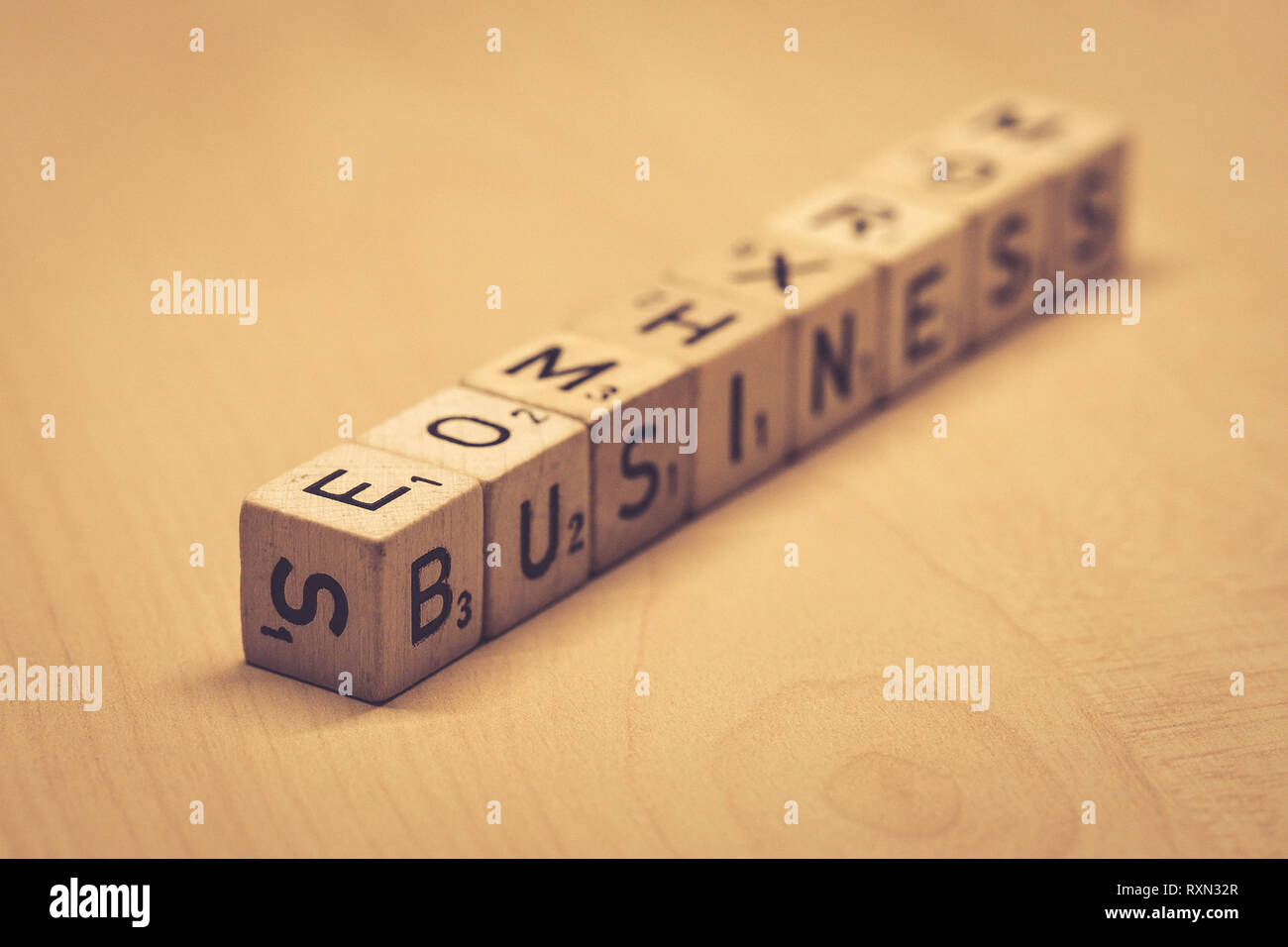 wooden cubes showing the word business on a table, office - Stock Image
