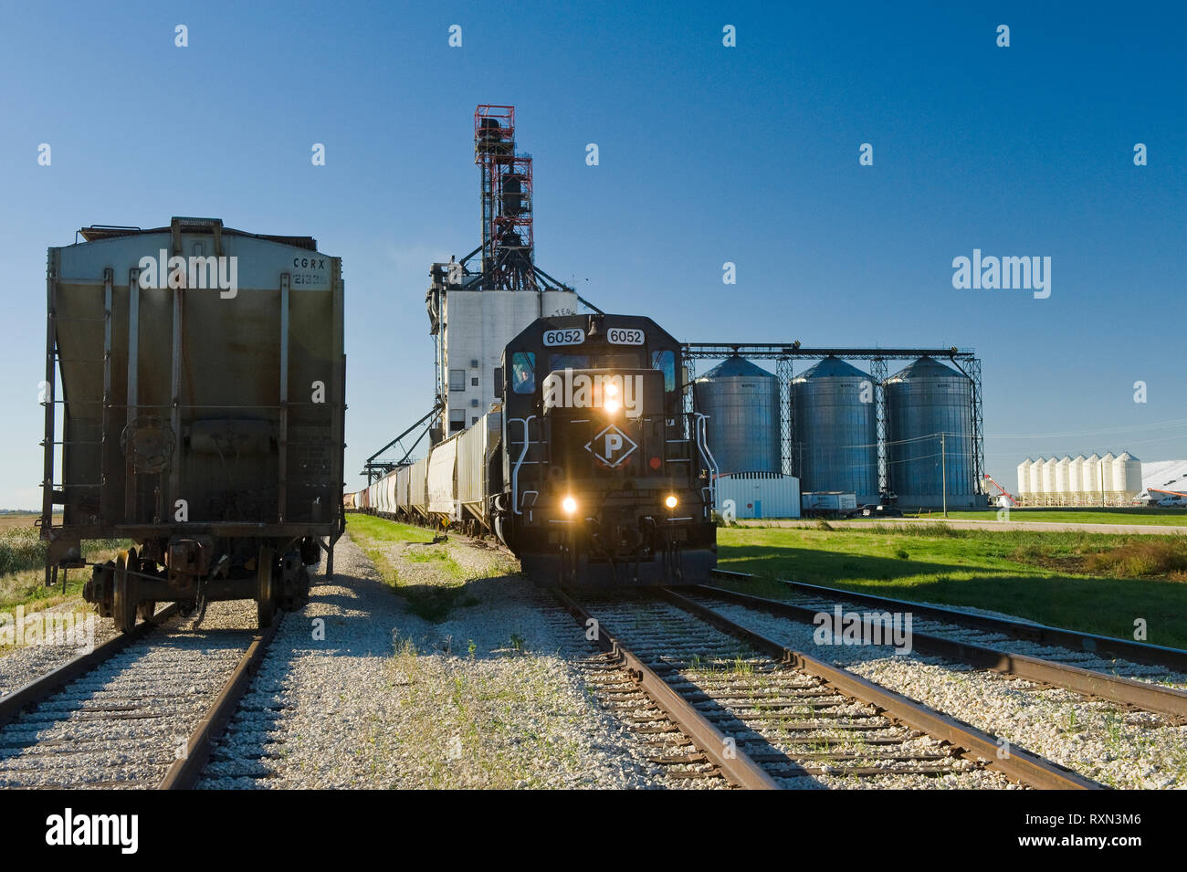 locomotive with rail hopper cars at an inland grain terminal, near Winnipeg, Manitoba, Canada Stock Photo