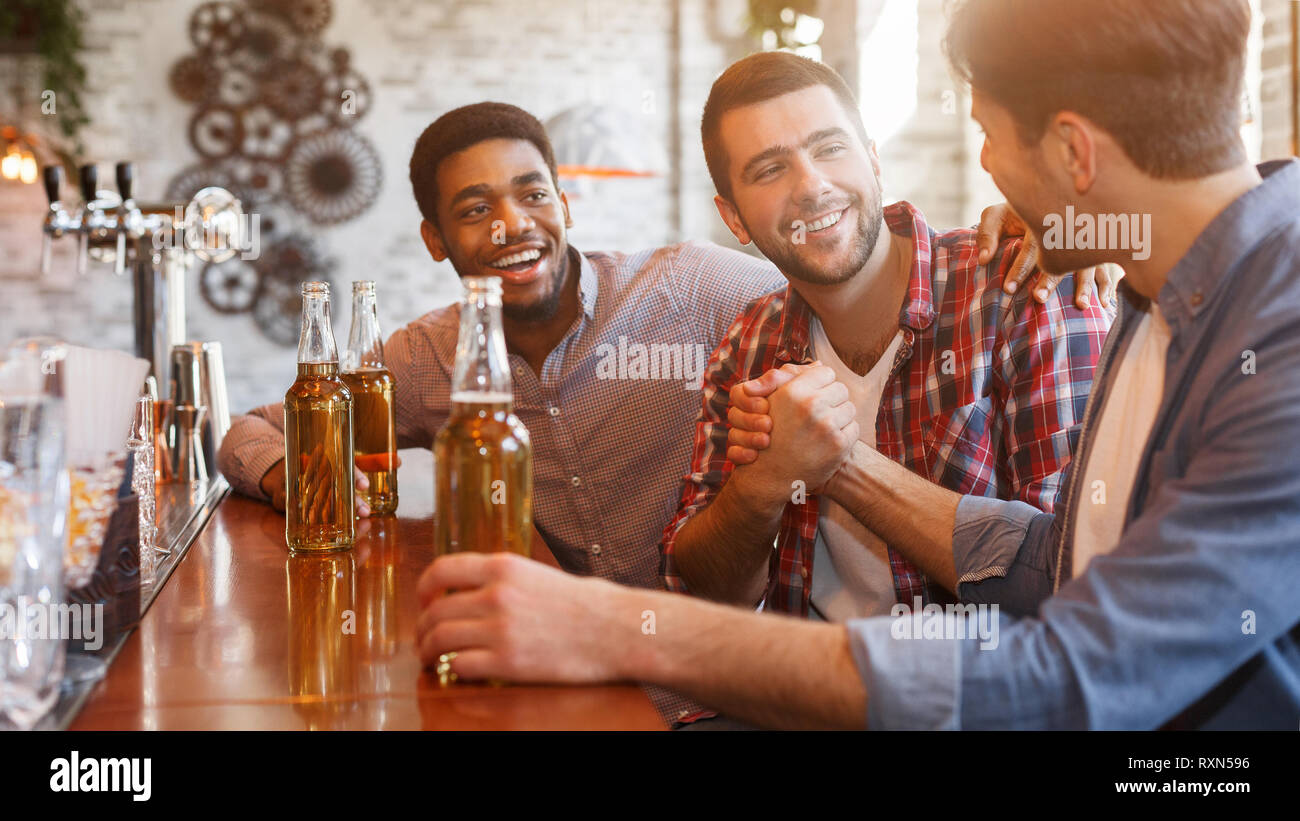 Happy to finally meet old friends in bar Stock Photo