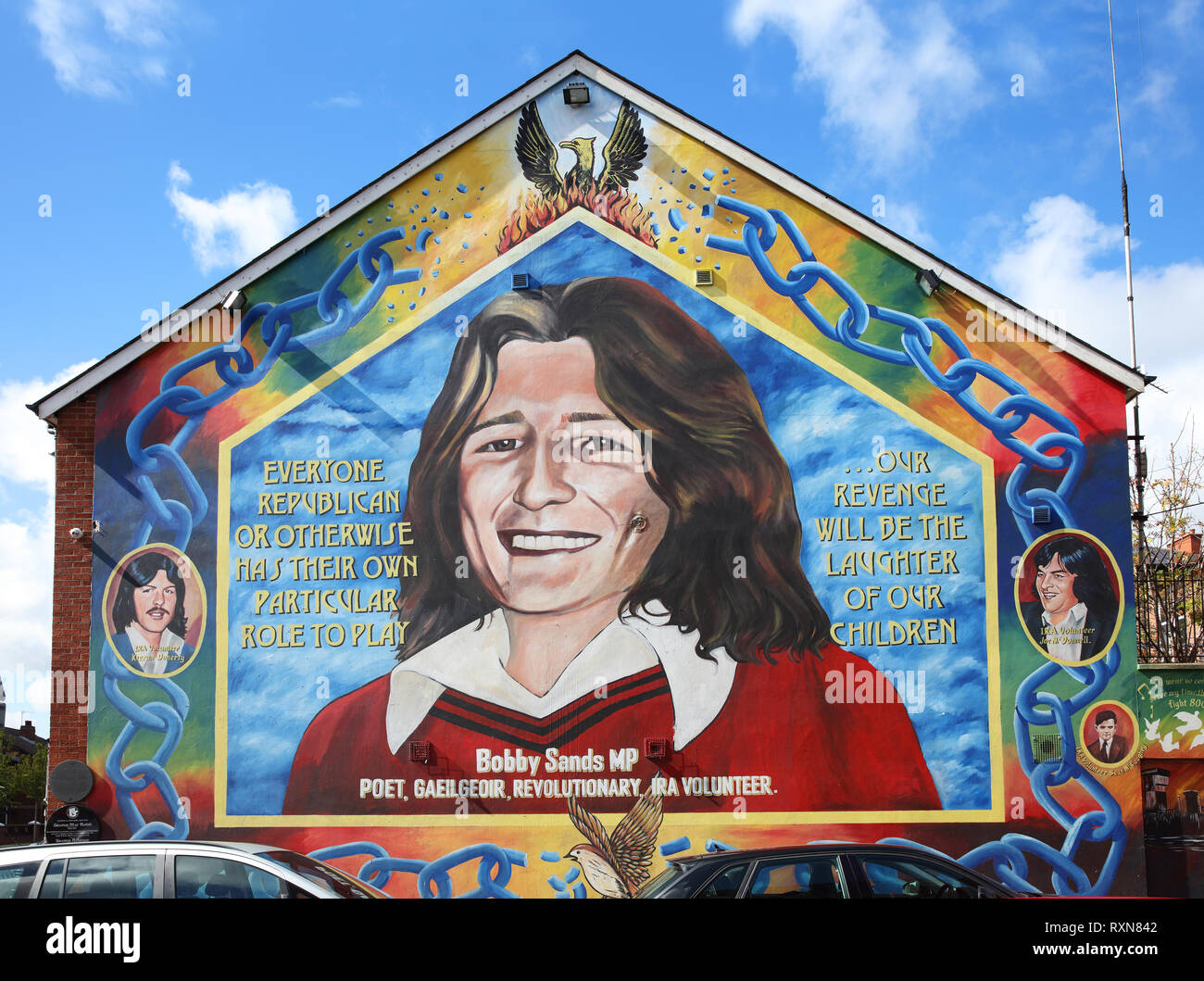 Mural dedicated to Bobby Sands, a volunteer with the Provisional IRA and leader of a hunger strike in 1981 that resulted in his death, Sinn Fein offices, corner of Falls and Sebastopol Roads, Belfast, Northern Island - Stock Image