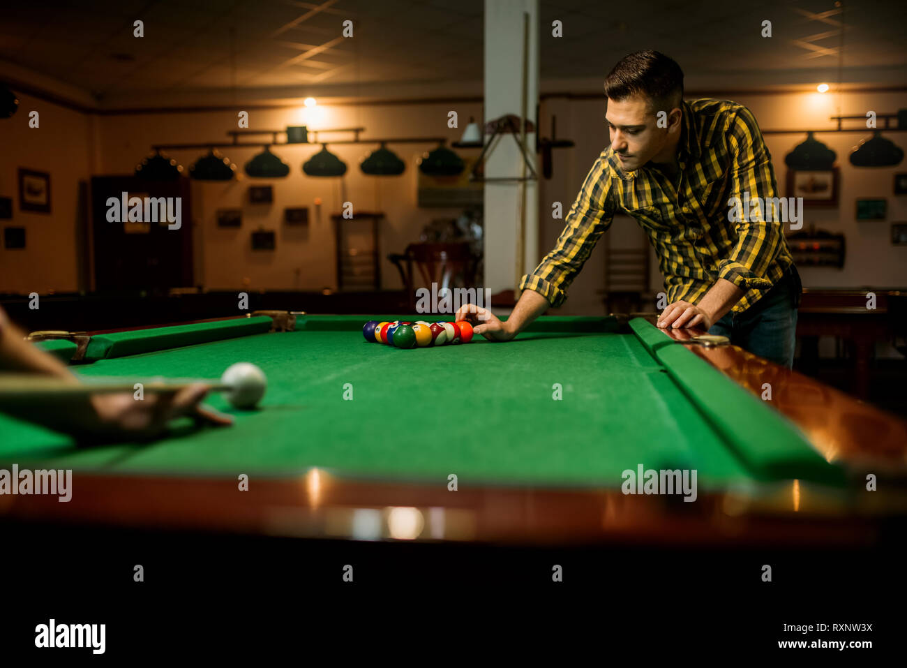 Two male billiard players leisures in poolroom - Stock Image