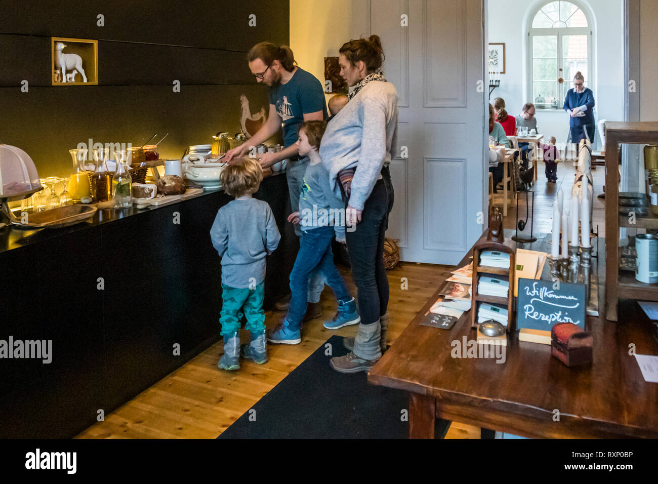 The Kavaliershaus has a lot to offer families with children. Everyone gets their money's worth at the breakfast buffet in the classroom of Hotel Kavaliershof in Fincken, Germany Stock Photo