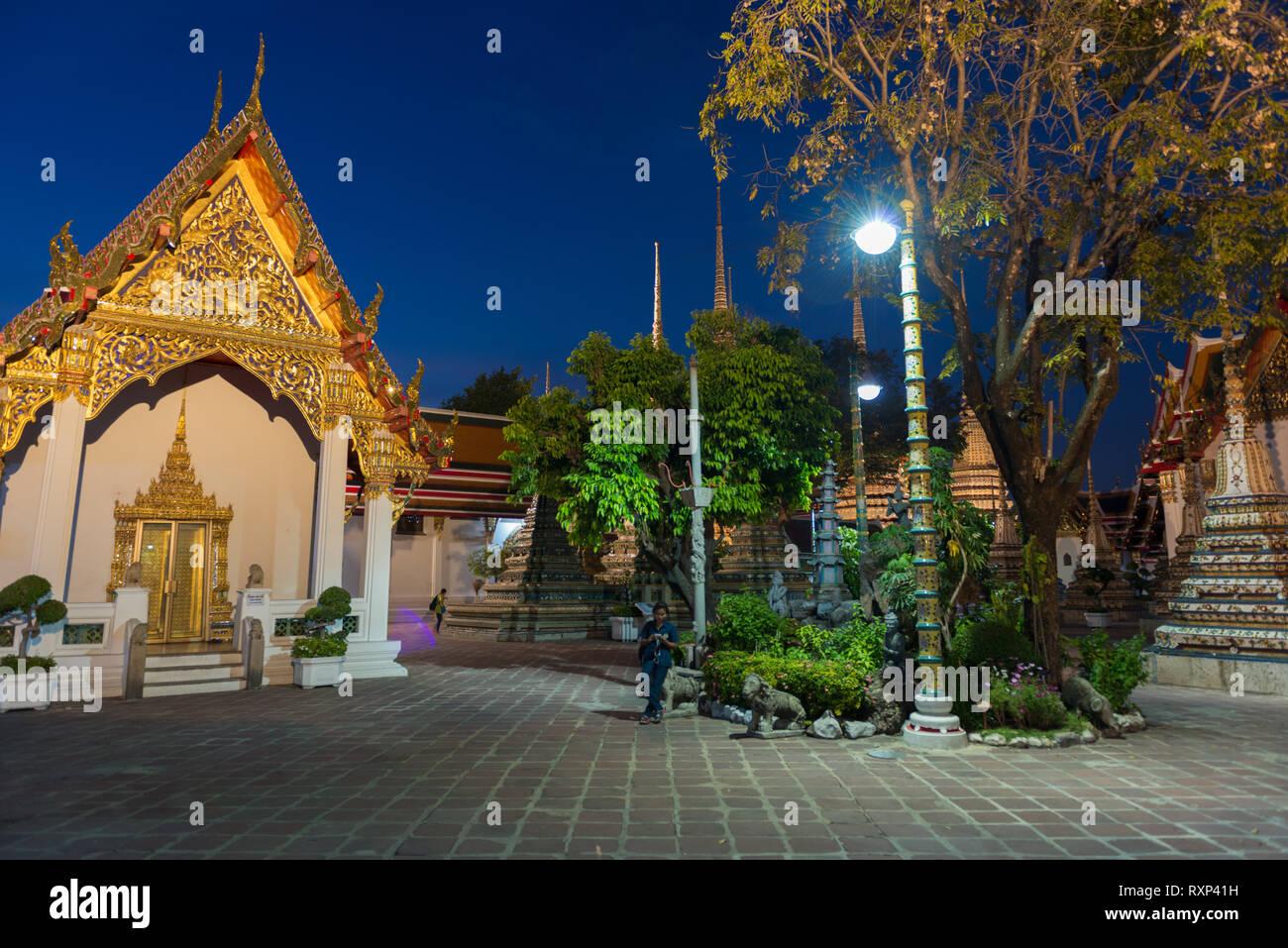 Night photo of Buddist temple Phra Maha Chedi in Bangkok, Thailand Stock Photo