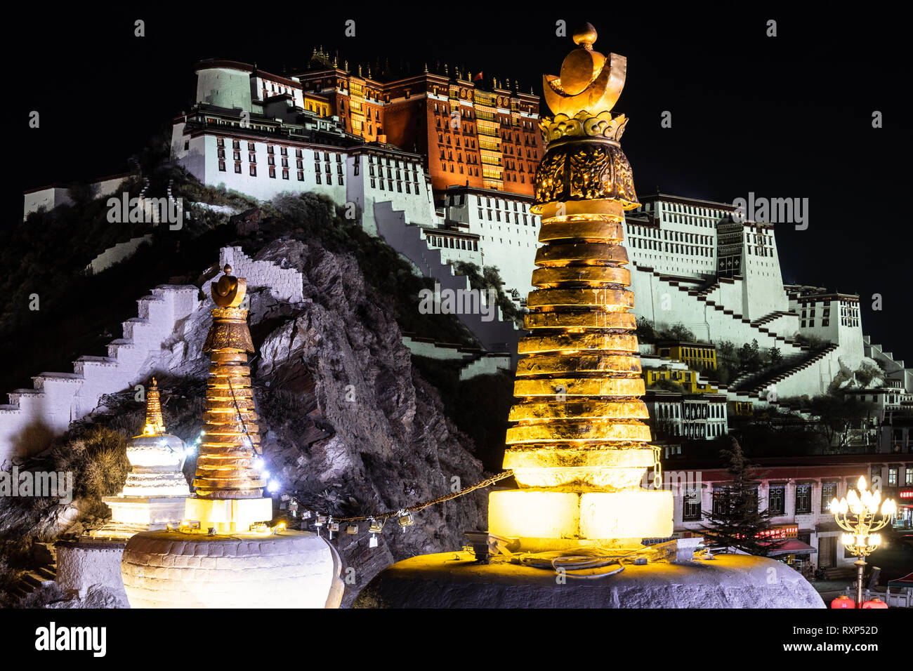 Night view of the illuminated Potala palace in Lhasa old town in Tibet, China - Stock Image