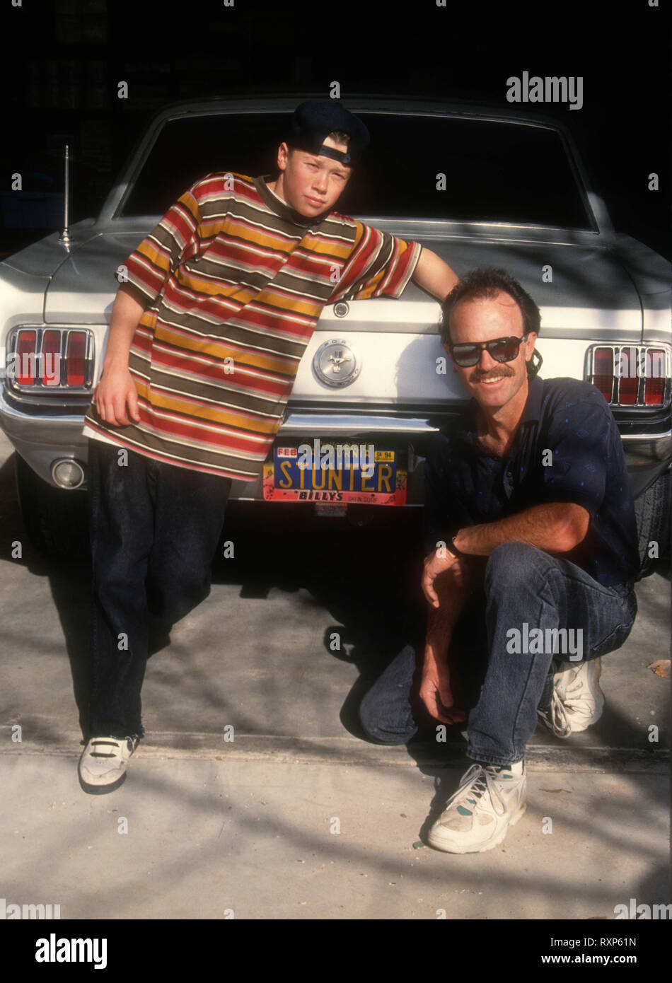LOS ANGELES, CA - FEBRUARY 13: (EXCLUSIVE) Stuntman/actor Mickey Cassidy and his father stuntman Michael Cassidy pose at a photo shoot on February 13, 1994 in Los Angeles, California. Photo by Barry King/Alamy Stock Photo - Stock Image