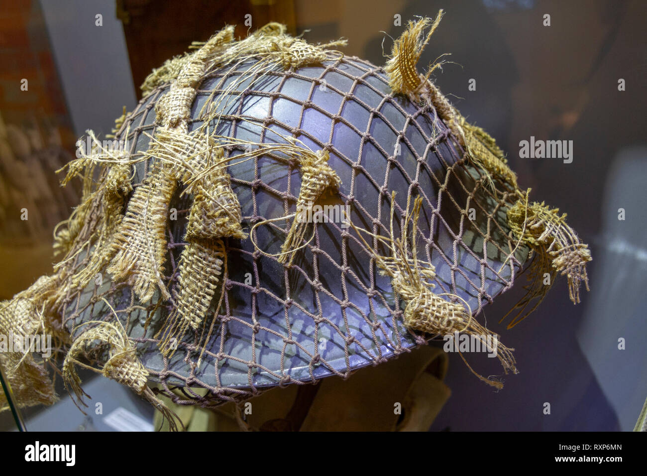 A World War II Allied MKII helmet with camouflage on display at the Juno Beach Centre, Courseulles-sur-Mer, Normandy, France. - Stock Image
