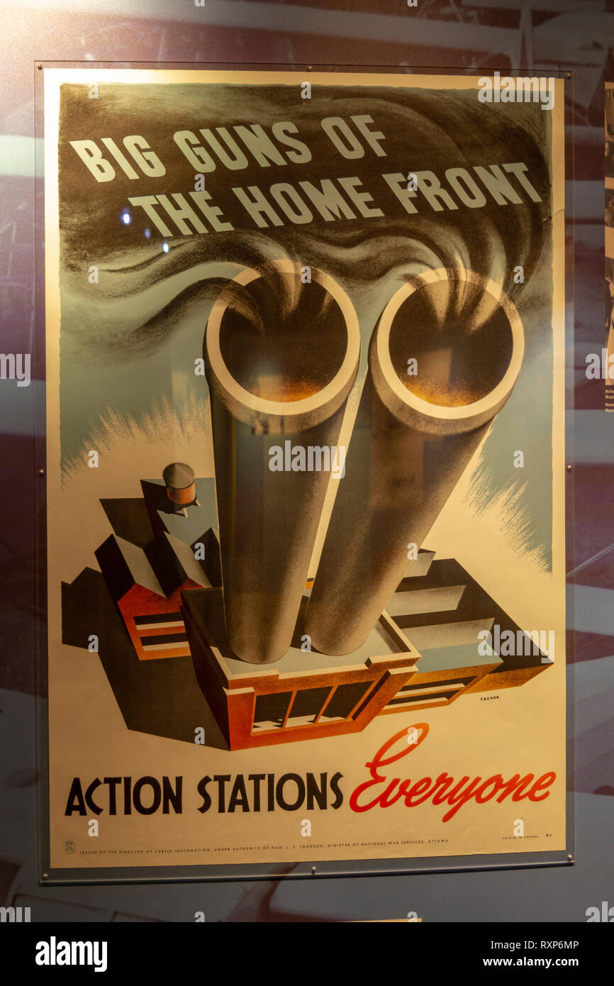 'Big Guns of the Home Front - Actions Stations Everyone,' poster on display at the Juno Beach Centre, Courseulles-sur-Mer, Normandy, France. - Stock Image