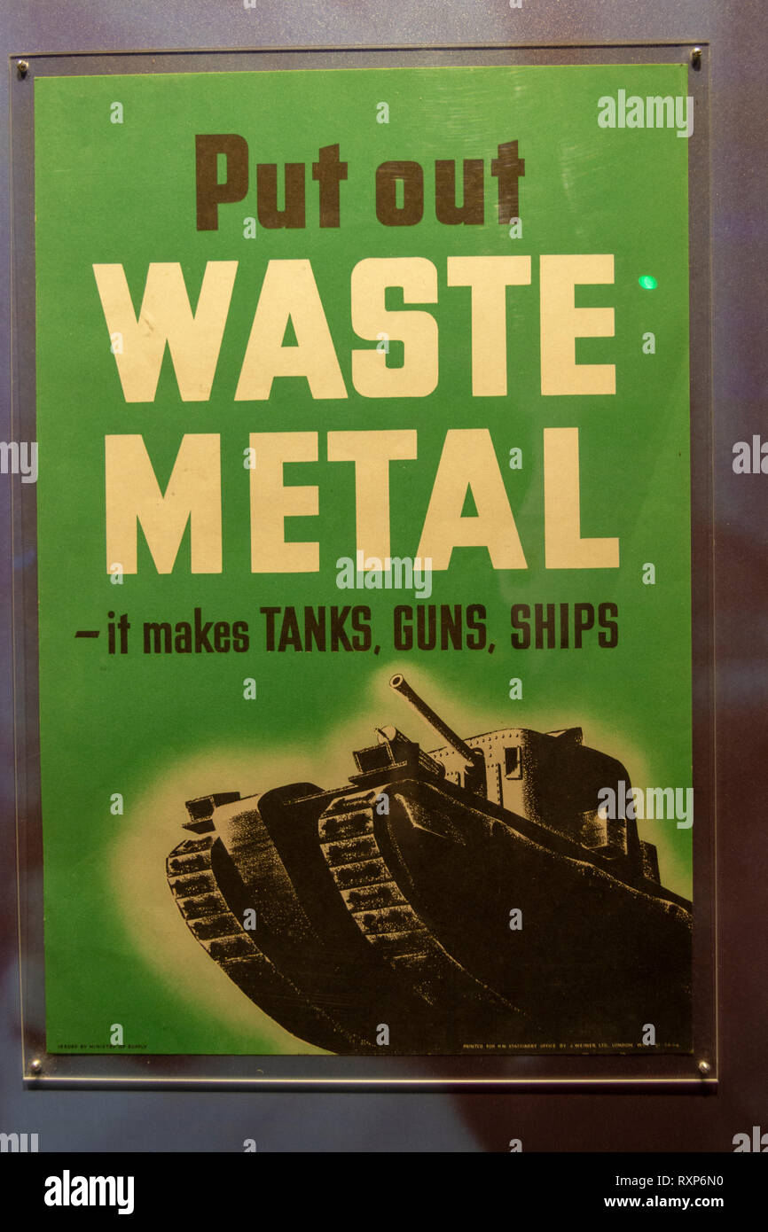 'Put Out Waste Metal-it makes tanks, guns, ships' poster on display at the Juno Beach Centre, Courseulles-sur-Mer, Normandy, France. - Stock Image