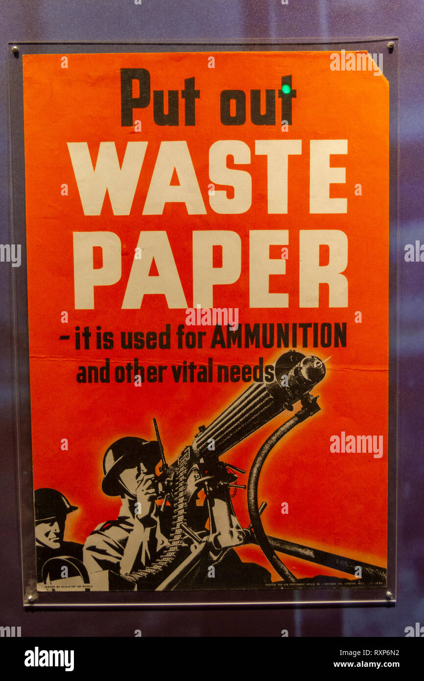 'Put Out Waste Paper-it is used for ammunition and other vital needs' poster, Juno Beach Centre, Courseulles-sur-Mer, Normandy, France. - Stock Image