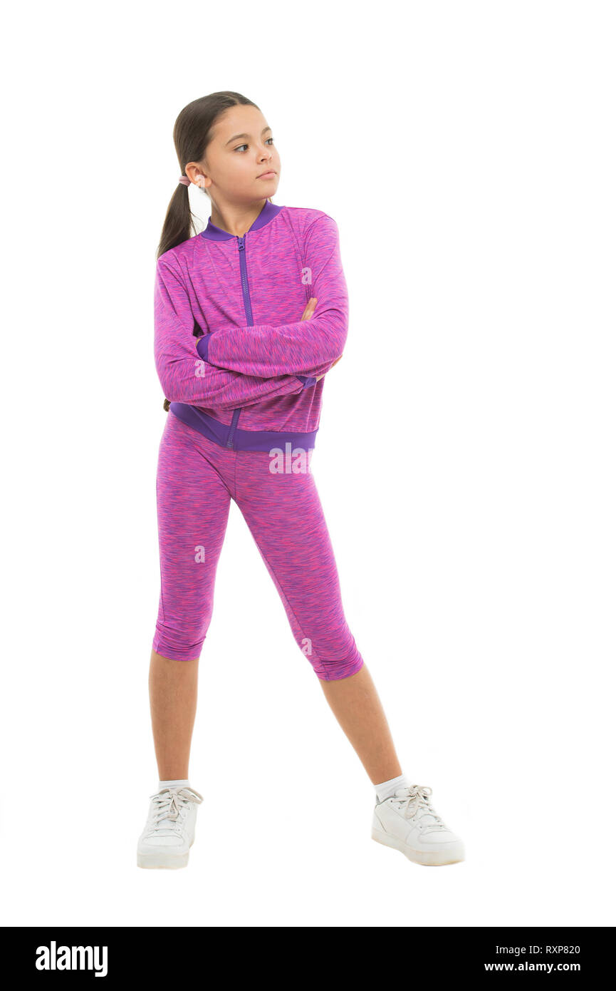 Deal with long hair while sport exercising. Working out with long hair. Girl cute kid with ponytails wear sport costume isolated on white. Stay comfortable with long hair during sport classes. - Stock Image