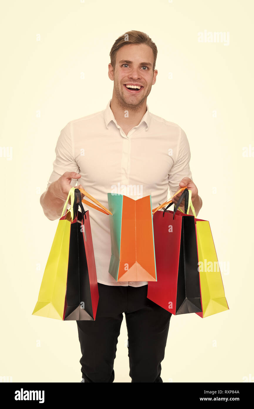 Shopping list. People overspend or buy things they not want, not need because they have not prepared properly. Guy happy shopped with list bought exactly what he needs. Man carry shopping bag. - Stock Image