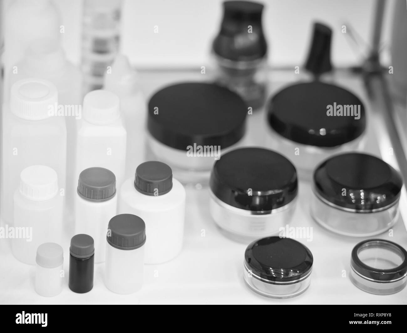 empty blank beauty product or skincare cosmetology plastic bottles or colorful flacons vial on light background - Stock Image