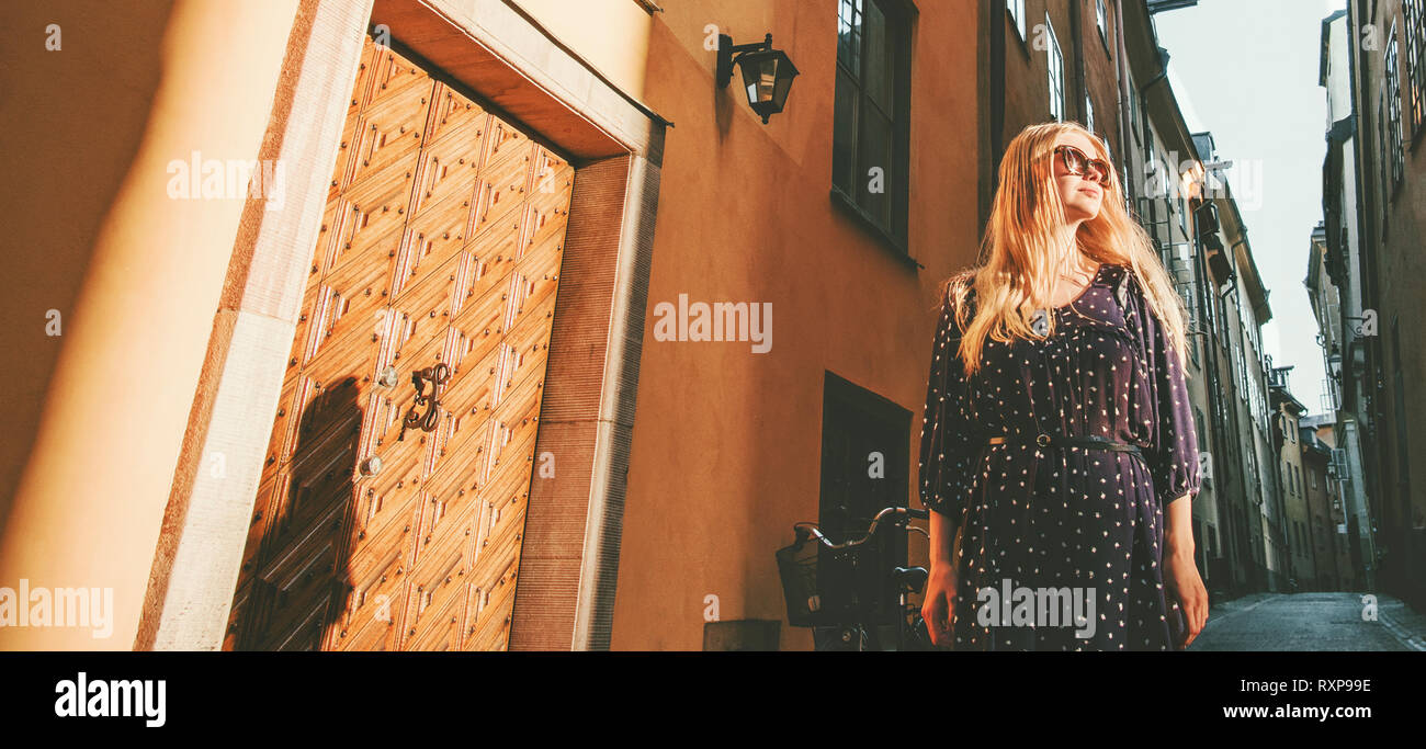 Stylish woman traveler walking city tour in Stockholm lifestyle summer vacations in Sweden travel - Stock Image