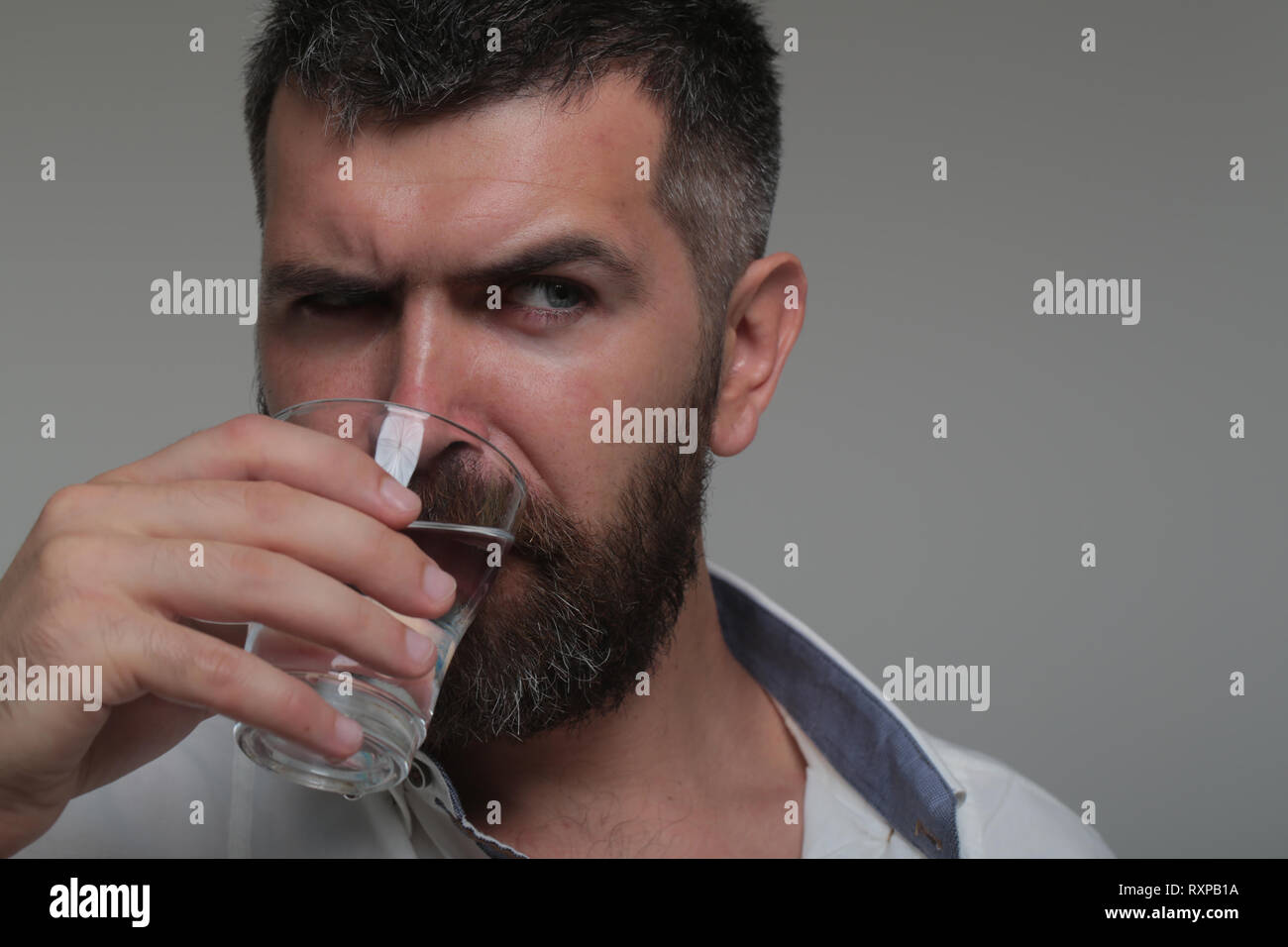 Bearded man drink water - Stock Image
