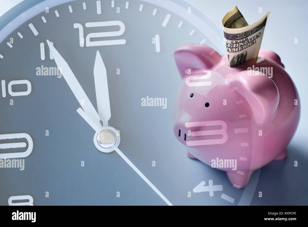 Savings, investment or nest egg concept with a pink piggy bank in a composite image with the dial of a clock showing passing time, deadline or countdo - Stock Image